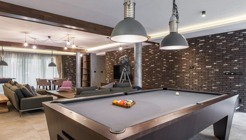 Man Cave with a pool table, and led lighting with TV on the wall